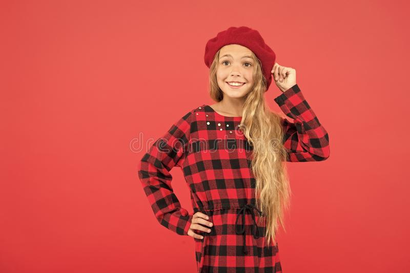 Beret style inspiration. How wear beret like fashion girl. Kid little girl with long hair posing in hat and checkered stock photography