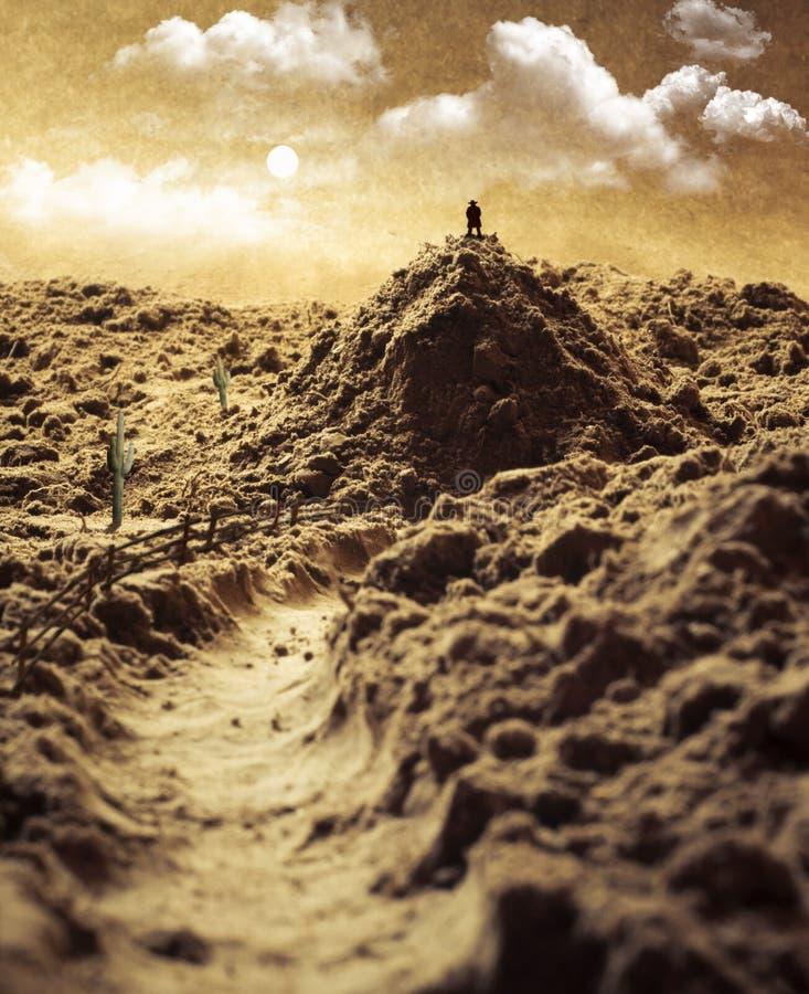Berg met een cowboy in een woestijn - macrosamenstelling van wild w royalty-vrije stock fotografie