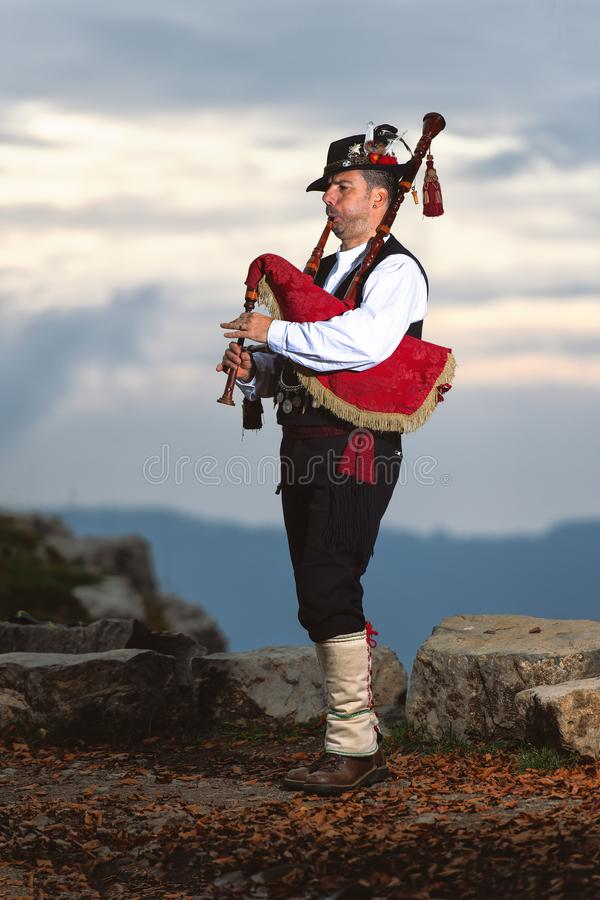 Bergamo Bagpipe. Player with traditional costume.  royalty free stock images