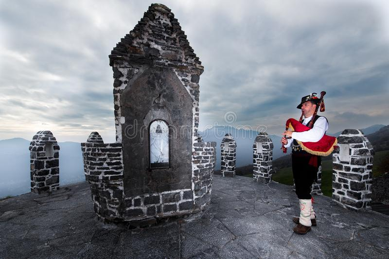 Bergamo Bagpipe. Player in a traditional religious chapel.  royalty free stock photo