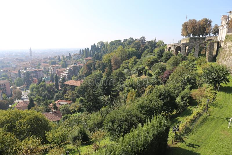 Bergamo. Is a city in Lombardy, Italy. It is situated about 40 km (25 mi) northeast of Milan and 30 km (19 mi) from the lakes Como and Iseo. The foothills of stock photography