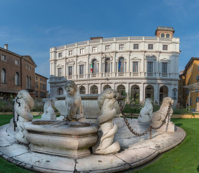 Bergamo. Fountain in the old square with background of the carrara bergamo library royalty free stock images