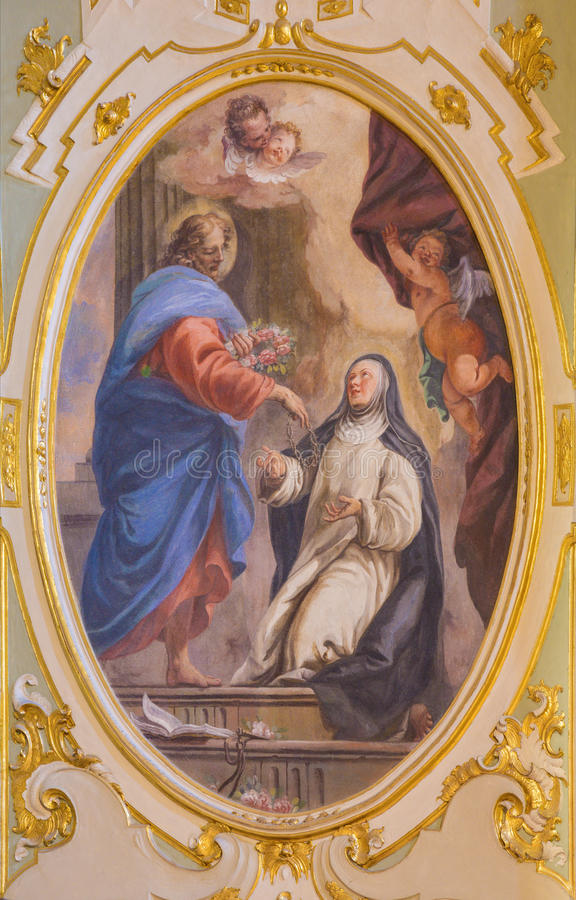 BERGAMO ITALIEN - MARS 16, 2017: Freskomålningen av syn av Jesus till helgonet Catherine i den kyrkliga Chiesa deien SS Bartolome arkivfoton