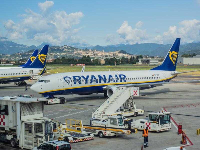 Bergamo, Italy. A Boeing 737-800 Ryanair at the Milano Bergamo International Airport. In the background the old town on the hill stock photo