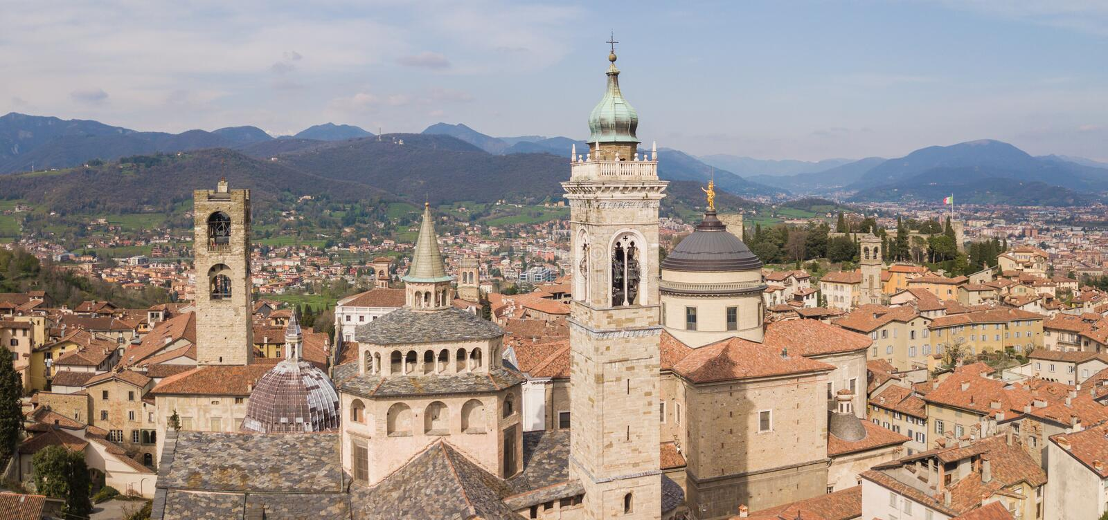 Bergamo, Italy. Drone aerial view of the old town. Landscape at the city center, its historical buildings, churches and towers stock image