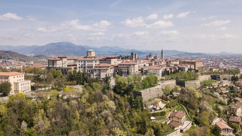 Bergamo, Italy. Drone aerial view of the old town. Landscape at the city center, its historical buildings and the Venetian walls royalty free stock photos