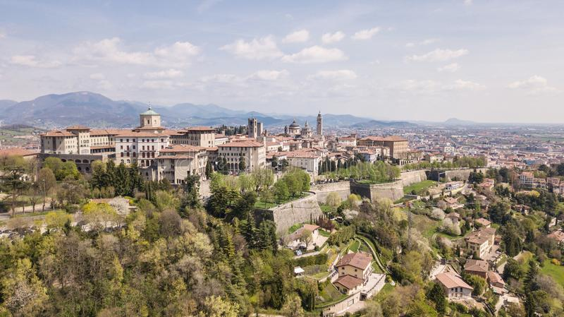 Bergamo, Italy. Drone aerial view of the old town. Landscape at the city center, its historical buildings and the Venetian walls royalty free stock photo