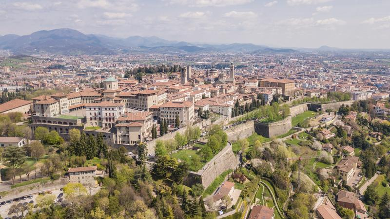 Bergamo, Italy. Drone aerial view of the old town. Landscape at the city center, its historical buildings and the Venetian walls stock photo