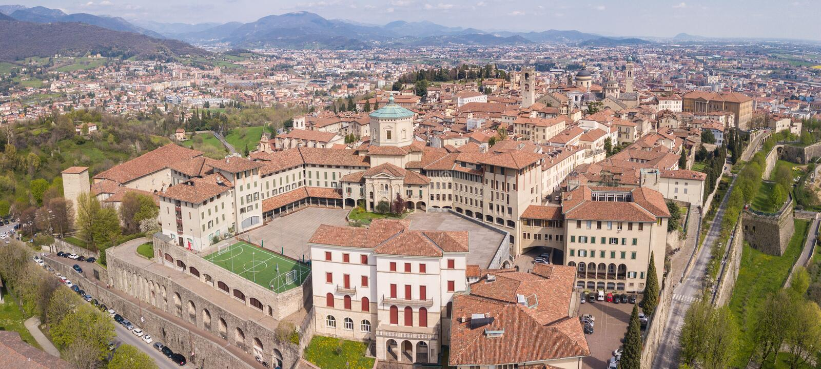 Bergamo, Italy. Drone aerial view of the old town. Landscape at the city center, its historical buildings and the Venetian walls royalty free stock photography