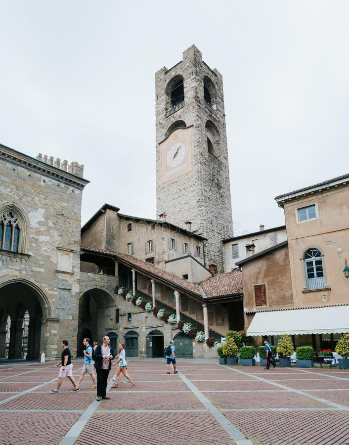 BERGAMO, ITALY - JUNE 16, 2016: People at Piacca Vecchia, in Front of Civic Tower (Torre Civica Campanone) in CItta Alta (old town royalty free stock images