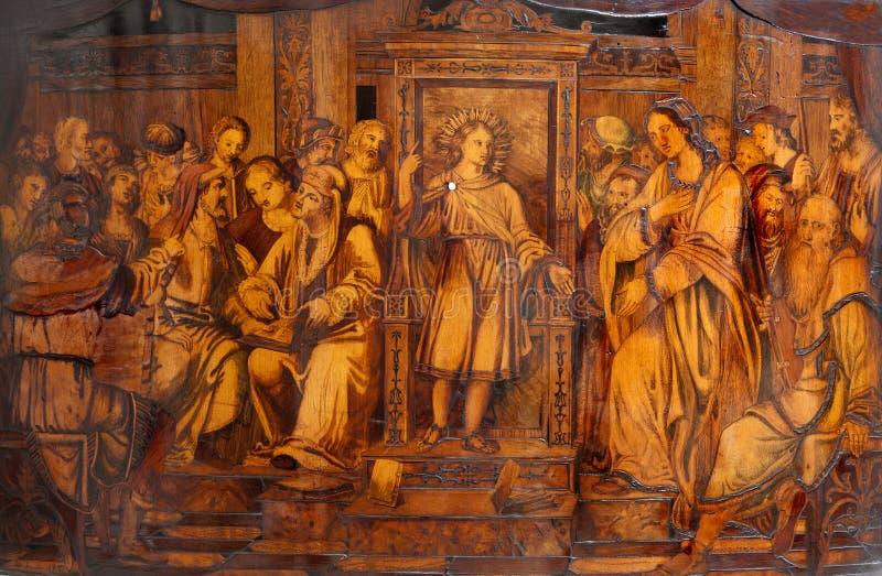 BERGAMO - JANUARI 29: Het onderwijs van Jesus van de jongen in de Tempel. Intarzia stock afbeelding