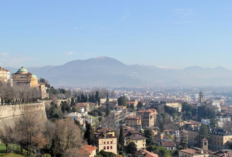 Bergamo old Italian town medieval buildings urban panorama beautiful cityscape blue sky horizon mountains. Old medieval Italian town Bergamo city buildings urban stock images