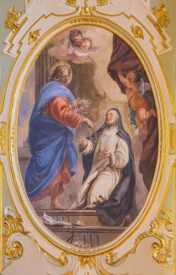 BERGAMO WŁOCHY, MARZEC, - 16, 2017: Fresk apparition Jezus święty Catherine w kościelnym Chiesa dei SS Bartolomeo e Stefan zdjęcia stock
