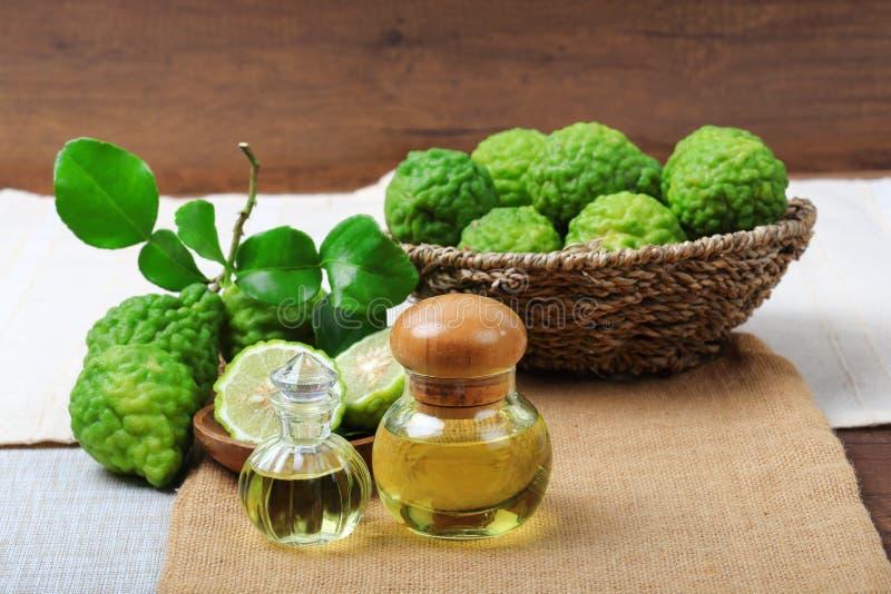 Bergamot with aromatic spa of bottles essential oil. Kaffir lime or bergamot with aromatic spa of bottles essential oil on sack background stock image