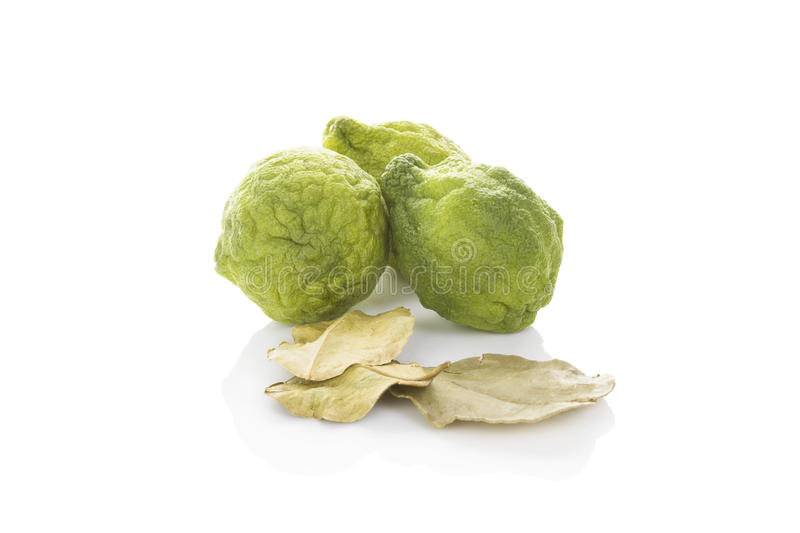 Bergamot fruit. Delicious ripe bergamot fruit with dry leaves isolated on white background. Culinary healthy tropical fruit stock photography