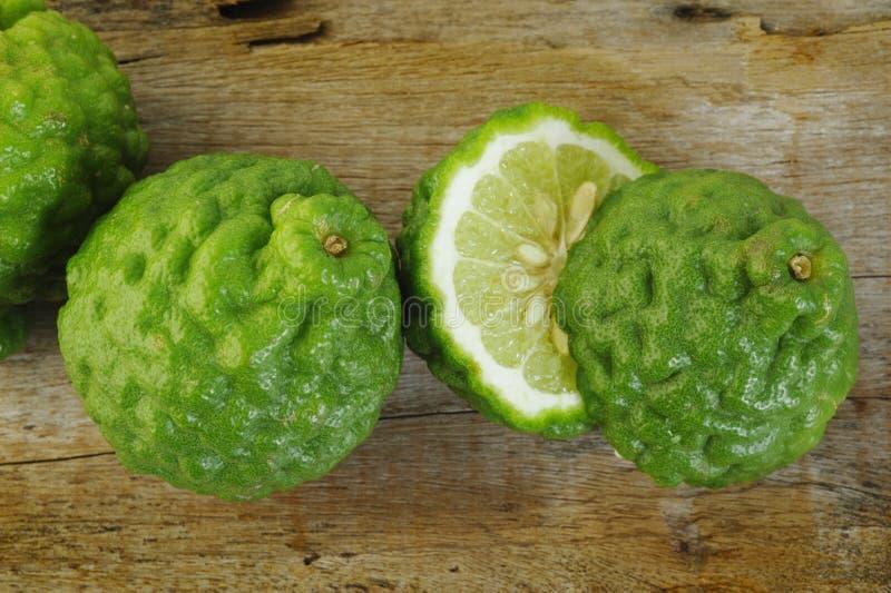 Bergamot fruit. On old wooden stock image