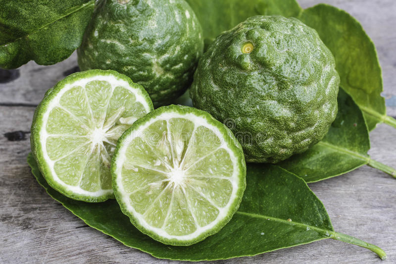 Bergamot with green leafs on wood stock photos