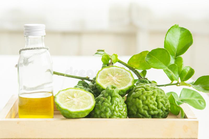 Bergamot and green leafs. In wood tray on table stock images