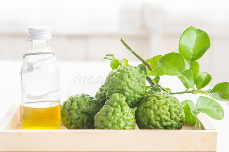 Bergamot and green leafs. In wood tray on table stock photo