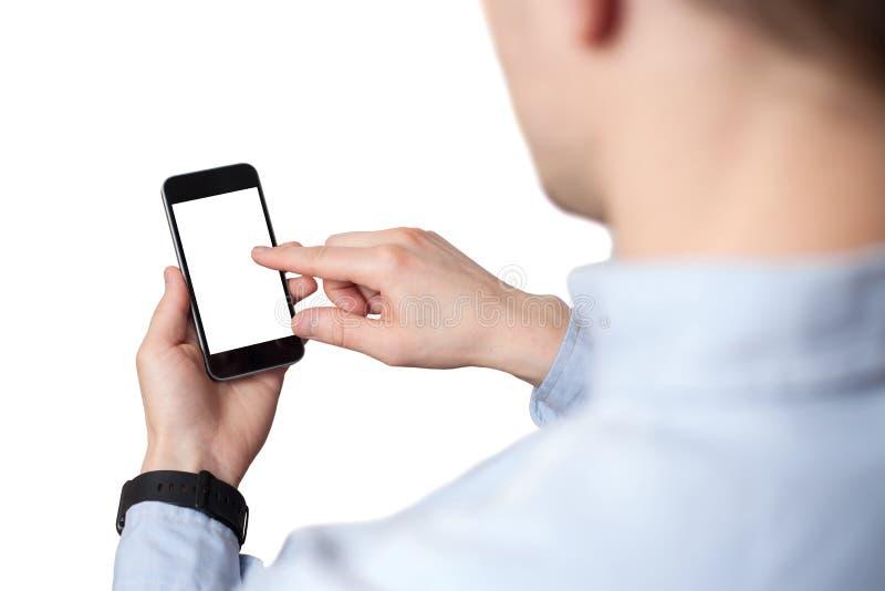 ?bergeben Sie das Halten und ber?hren Sie sich auf schwarzem Smartphone mit leerem Bildschirm auf wei?em Hintergrund stockfoto