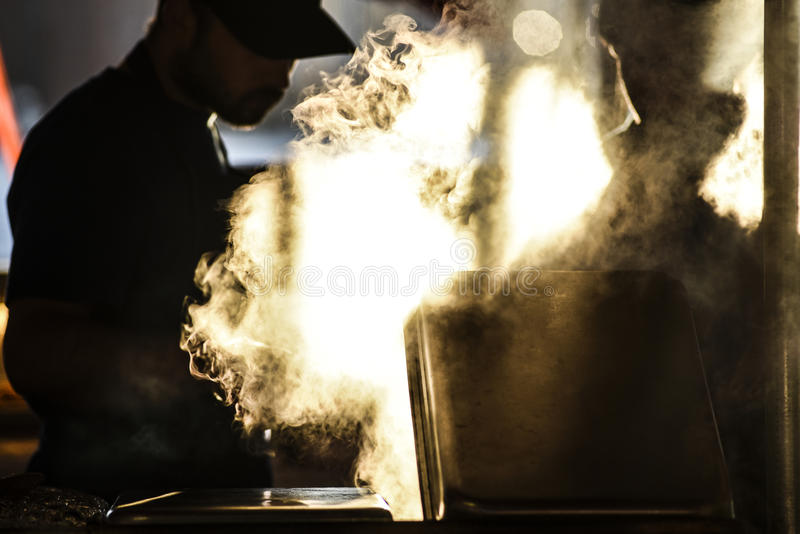 Bergen, Norway, 23 July 2017: Bergen Fishmarket, Water vapor esc. Aping from cooked food at Bergen`s fishmarket royalty free stock photography