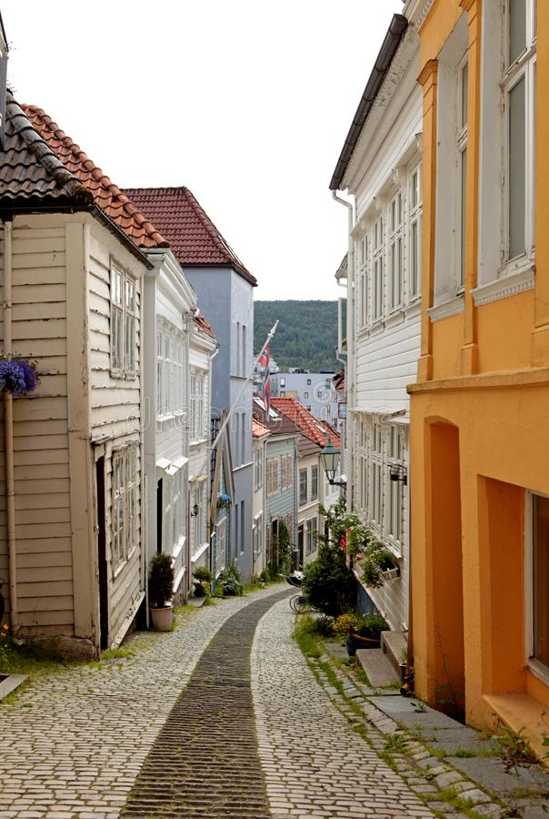 Bergen/Norway - July 05 2019: Cozy narrow street of the Bergen town with beautiful colourful wooden houses. Bergen, Norway. Cozy narrow street of the town with stock photo