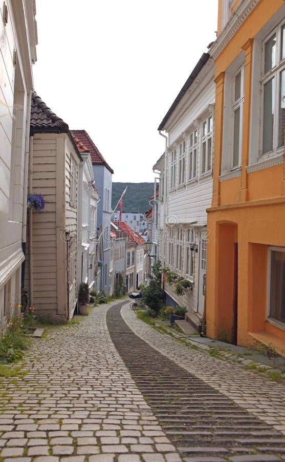 Bergen/Norway - July 05 2019: Cozy narrow street of the Bergen town with beautiful colourful wooden houses. Bergen, Norway. Cozy narrow street of the town with stock photography