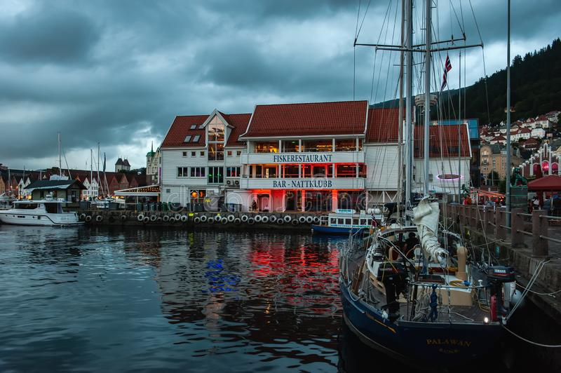 Bergen, Norway - July 30, 2013: Photo of Bergen Waterfront on a rainy evening. The coastline of the port of Bergen royalty free stock image