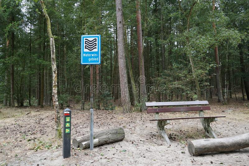 Water extraction location. Bergen op Zoom, the Netherlands. August 2019. Sign in a forest indicating a freshwater or drinking water collection or extraction area royalty free stock images