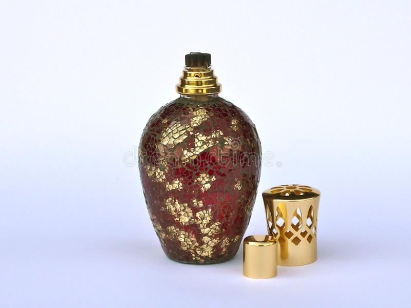 Berger red and golden lampe with crackled effect. The details of the closure are in gold color royalty free stock photos