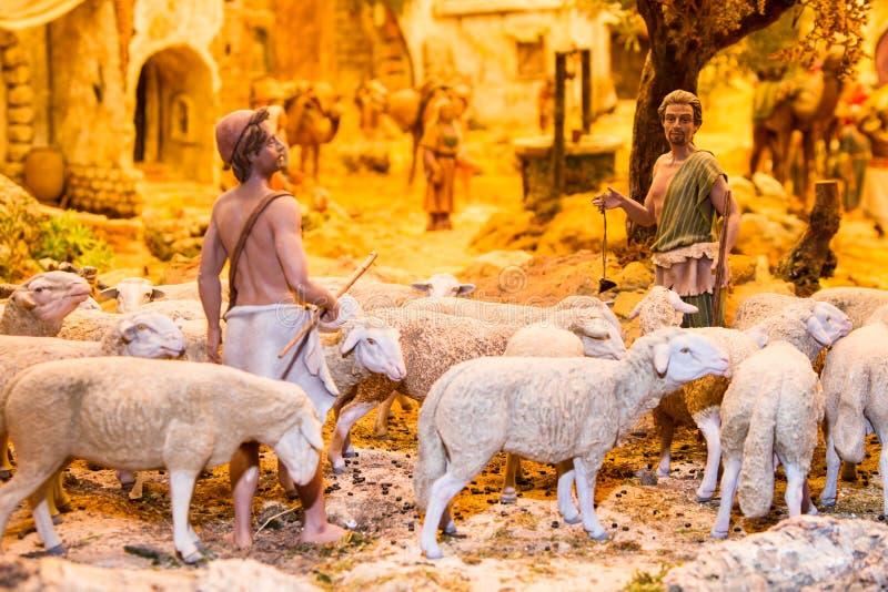 Bergers avec un troupeau de moutons images stock