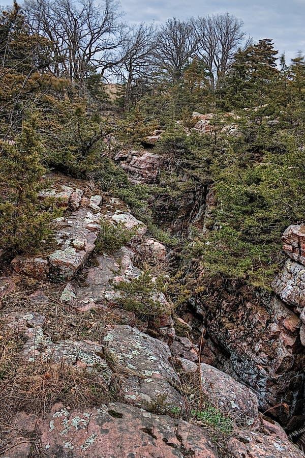Bergsklyftan för jäkel` s lokaliseras av Garretson, South Dakota och är, var berömt, kriminaliserar Jesse James som across hoppas royaltyfria foton