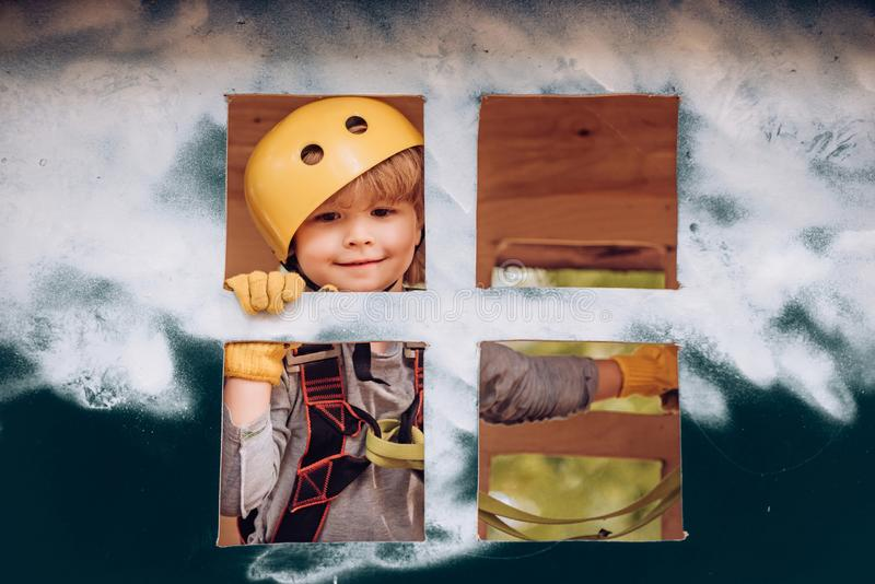 Bergsteigerkind auf Training Wandern im Seilparkmädchen in der Schutzausrüstung Roping Park Kleinkindkindergarten aktiv lizenzfreie stockfotos