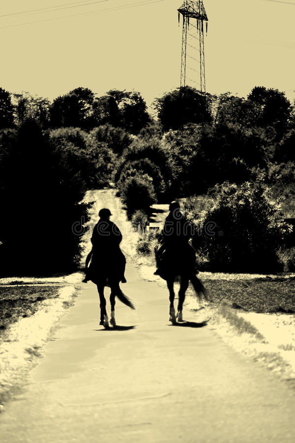 Berijdende silhouetten royalty-vrije stock fotografie