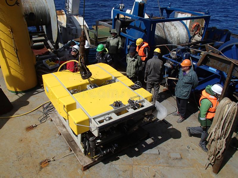 The Bering Sea / Russia - June 11 2016: Science expedition team on the stern of RV Akademik Lavrentyev preparing the ROV to deploy. Science expedition team on stock photo