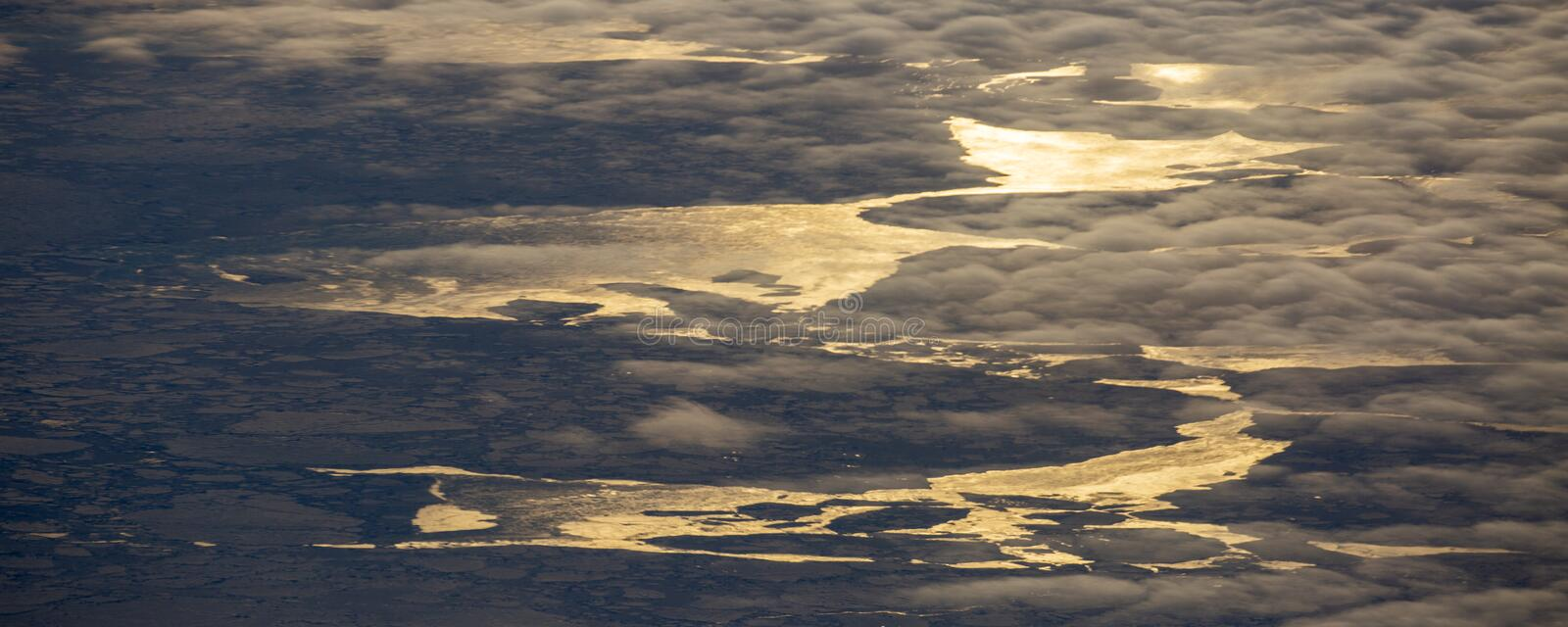 14Take an aerial view of the ice and sunrise over the bering strait.(1). The bering strait is located in the high latitudes, cold weather, many storms royalty free stock photos