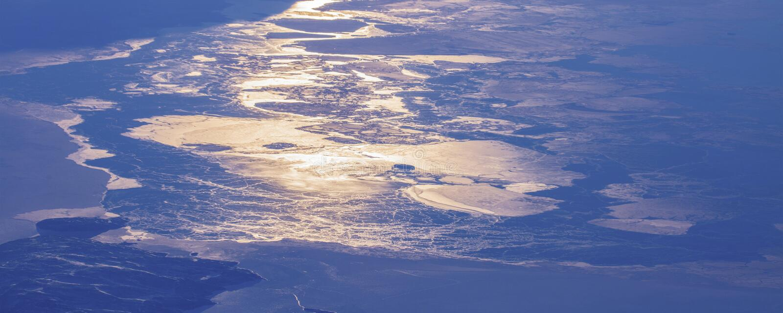 17Take an aerial view of the ice and sunrise over the bering strait.(1). The bering strait is located in the high latitudes, cold weather, many storms stock photography
