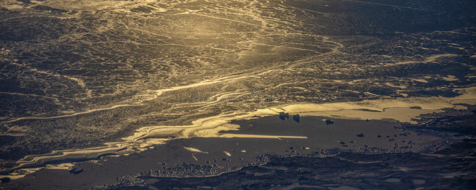 23Take an aerial view of the ice and sunrise over the bering strait.(1). The bering strait is located in the high latitudes, cold weather, many storms royalty free stock photos