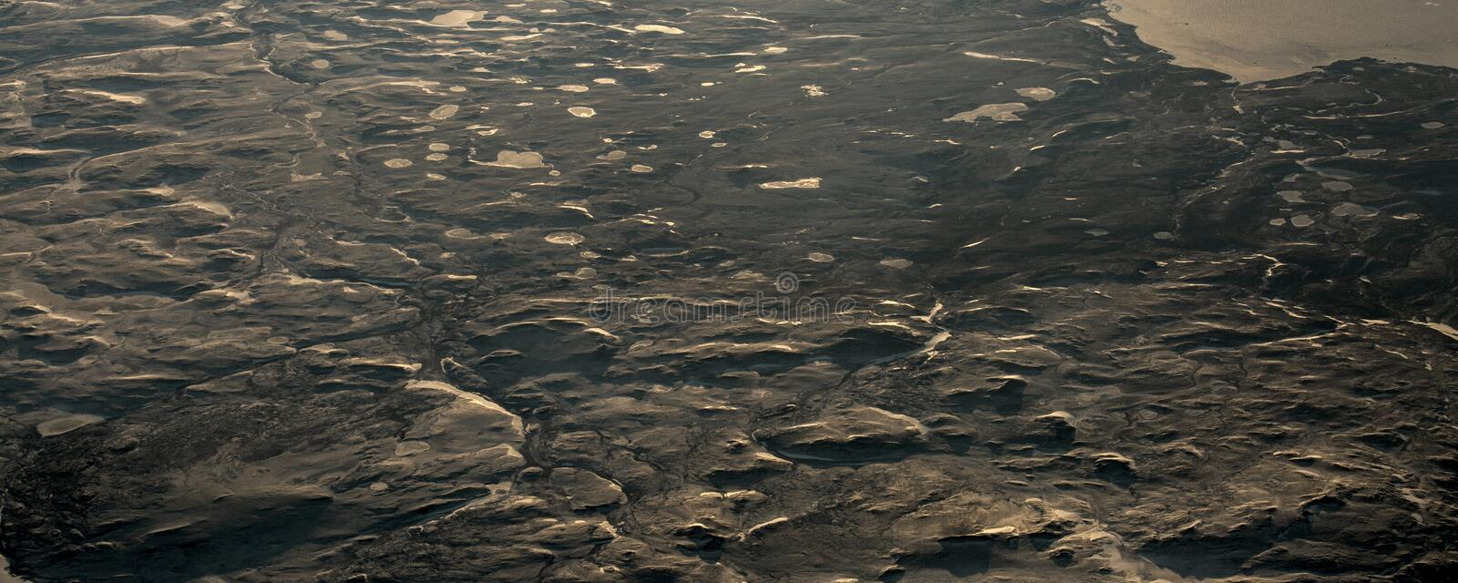 15Take an aerial view of the ice and sunrise over the bering strait.(1). The bering strait is located in the high latitudes, cold weather, many storms royalty free stock images