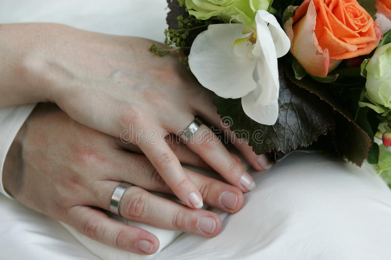 Beringed hands of a bridal couple royalty free stock photography