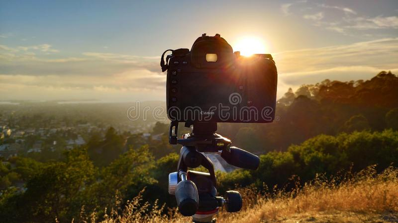 Canon 5D Mark IV on a Manfrotto tripod at Grizzly Peak in Berkeley Hills pointing at San Francisco covered with fog at sunset. Berkeley, United States - July 12 royalty free stock image