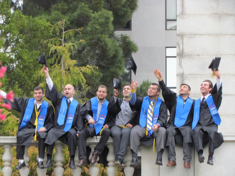 College students posing wearing on graduation day at Berkeley un stock image