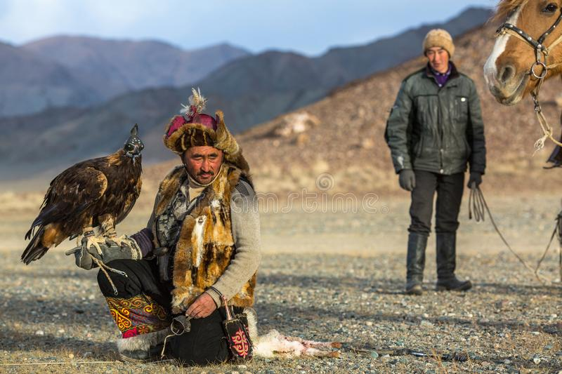 Download Berkutchi Eagle Hunter While Hunting To The Hare With A Golden Eagles On His Arms In The Mountains Of Bayan-Olgii Aimag. Editorial Stock Image - Image of kazakh, leisure: 111305919