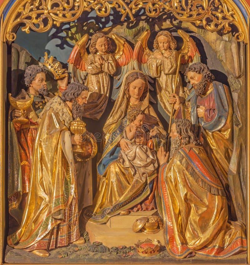 BERLÍN, ALEMANIA, FEBRERO - 16, 2017: El alivio tallado Pentecostés en el altar principal de la iglesia de los Dominicans de St P foto de archivo libre de regalías