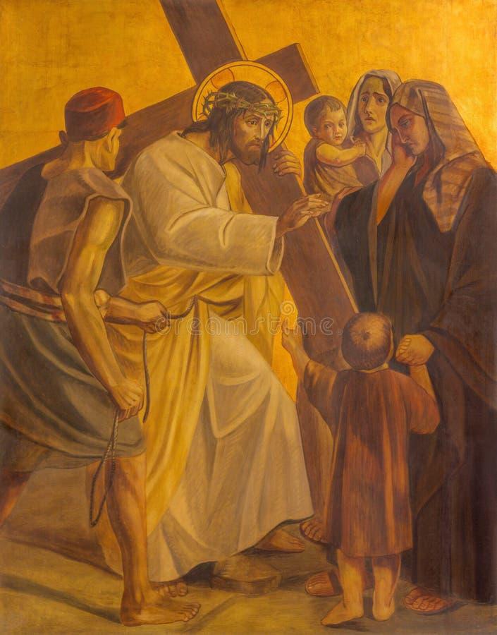 Berlijn - de verf op de metaalplaat - Jesus ontmoet de vrouwen van Jeruzalem in kerk St Matthew stock foto's