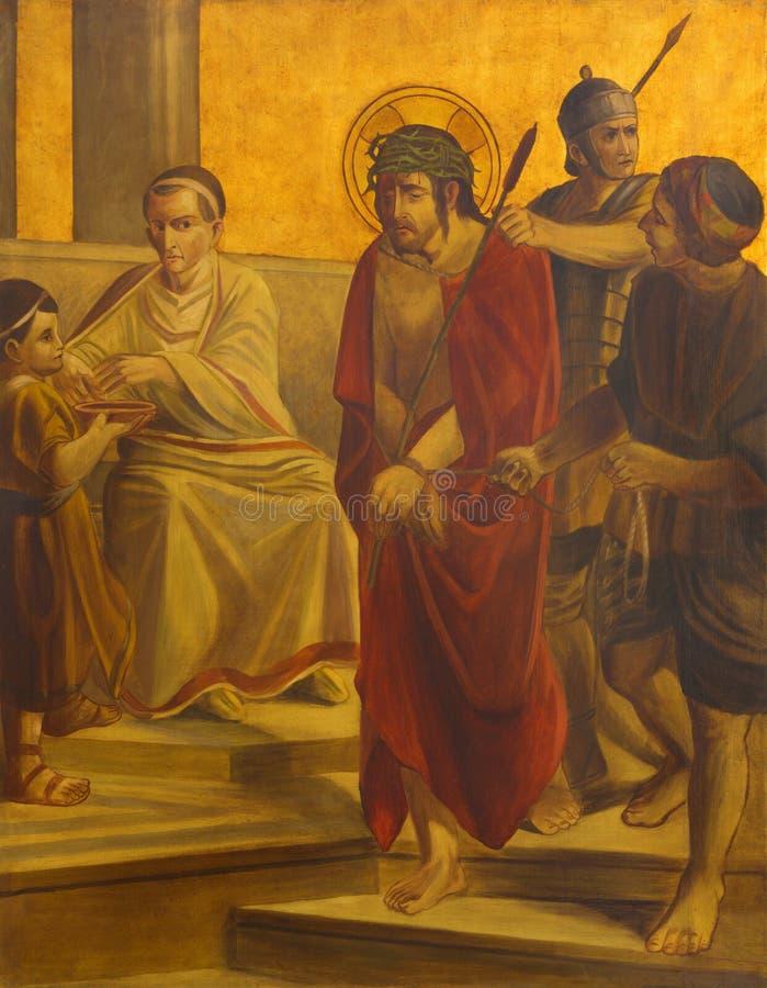 BERLIM, ALEMANHA, FEVEREIRO - 16, 2017: A pintura na placa de metal - julgamento de Jesus para Pilate imagem de stock royalty free