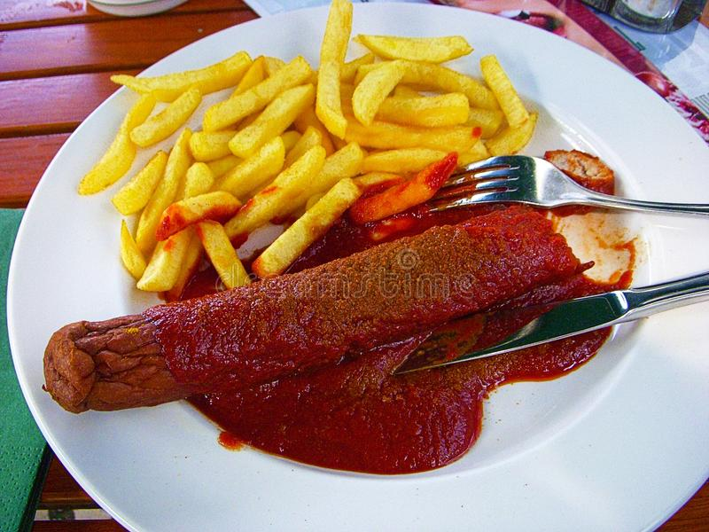 Berlinês famoso Currywurst imagem de stock royalty free