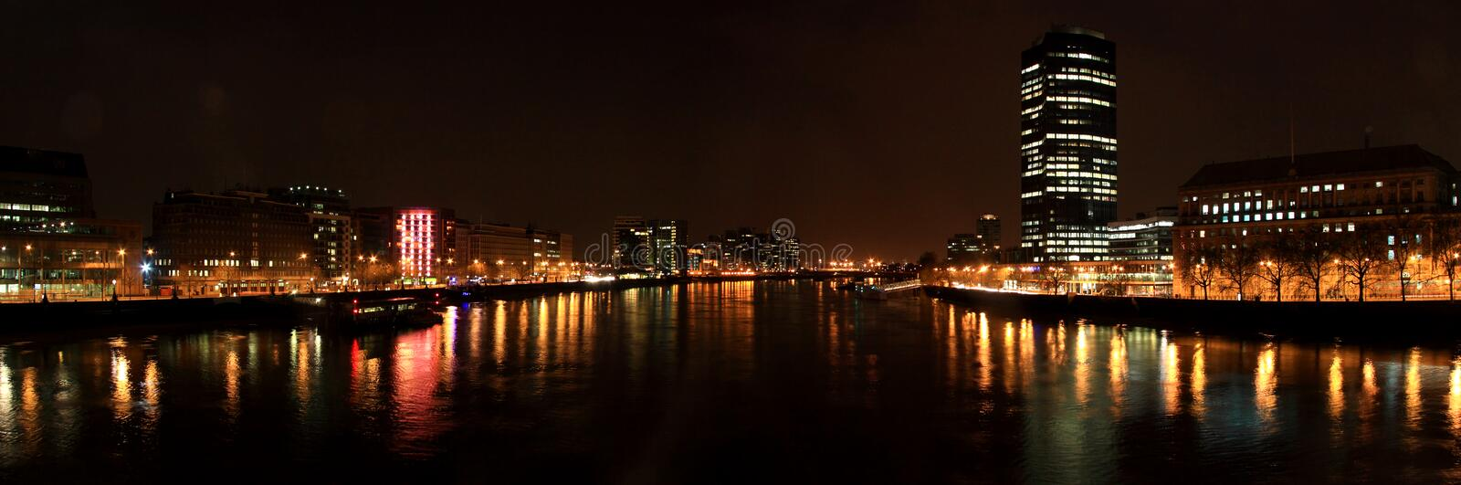 The River Thames at Night, London. The River Thames at night looking west, London stock photos