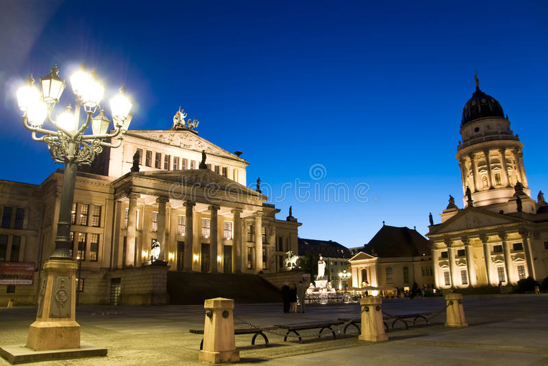 Berlin gendarmenmarkt. Berlin, gendarmenmarkt at sunset with deep blue sky royalty free stock image