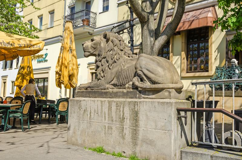 Lion sculpture at the entrance to the pedestrian walkway under t stock images